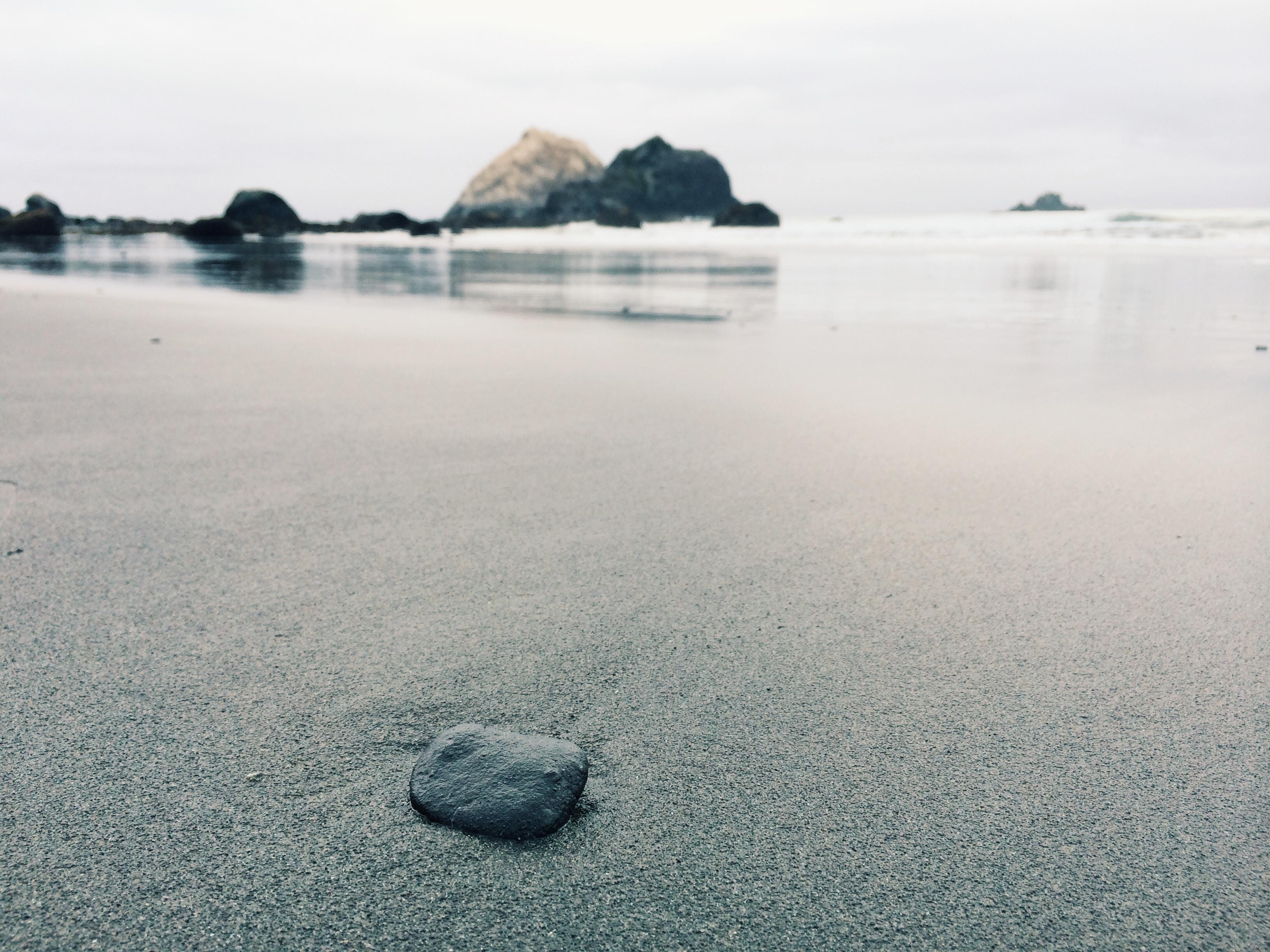 black stone on shoreline