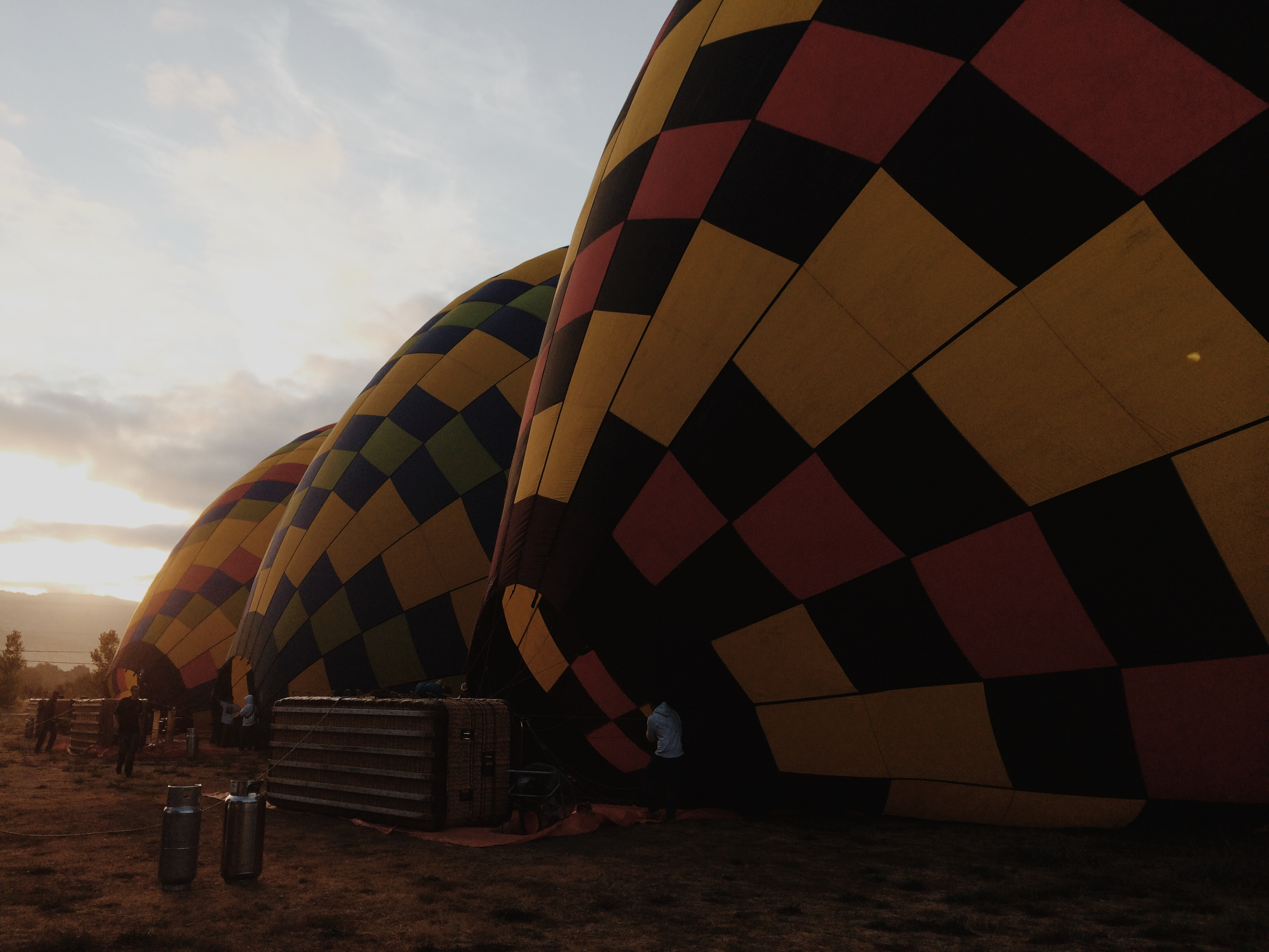 Three hot air balloons on the ground