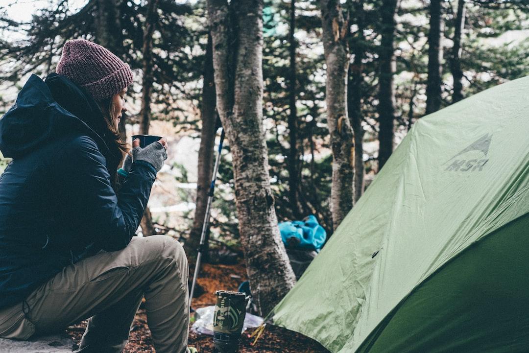 Female camper enjoying morning tea