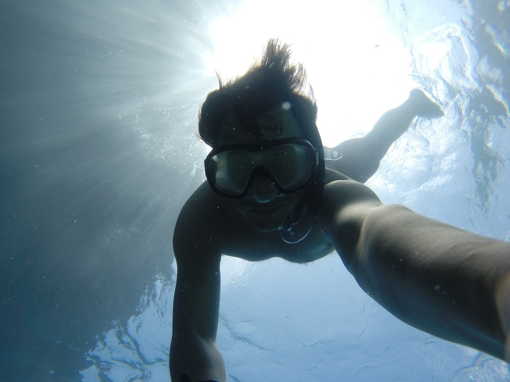 man swimming underwater