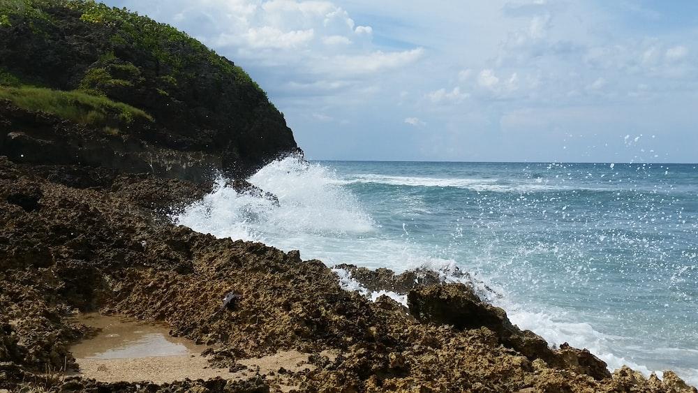 sea waves crashing through rock shore