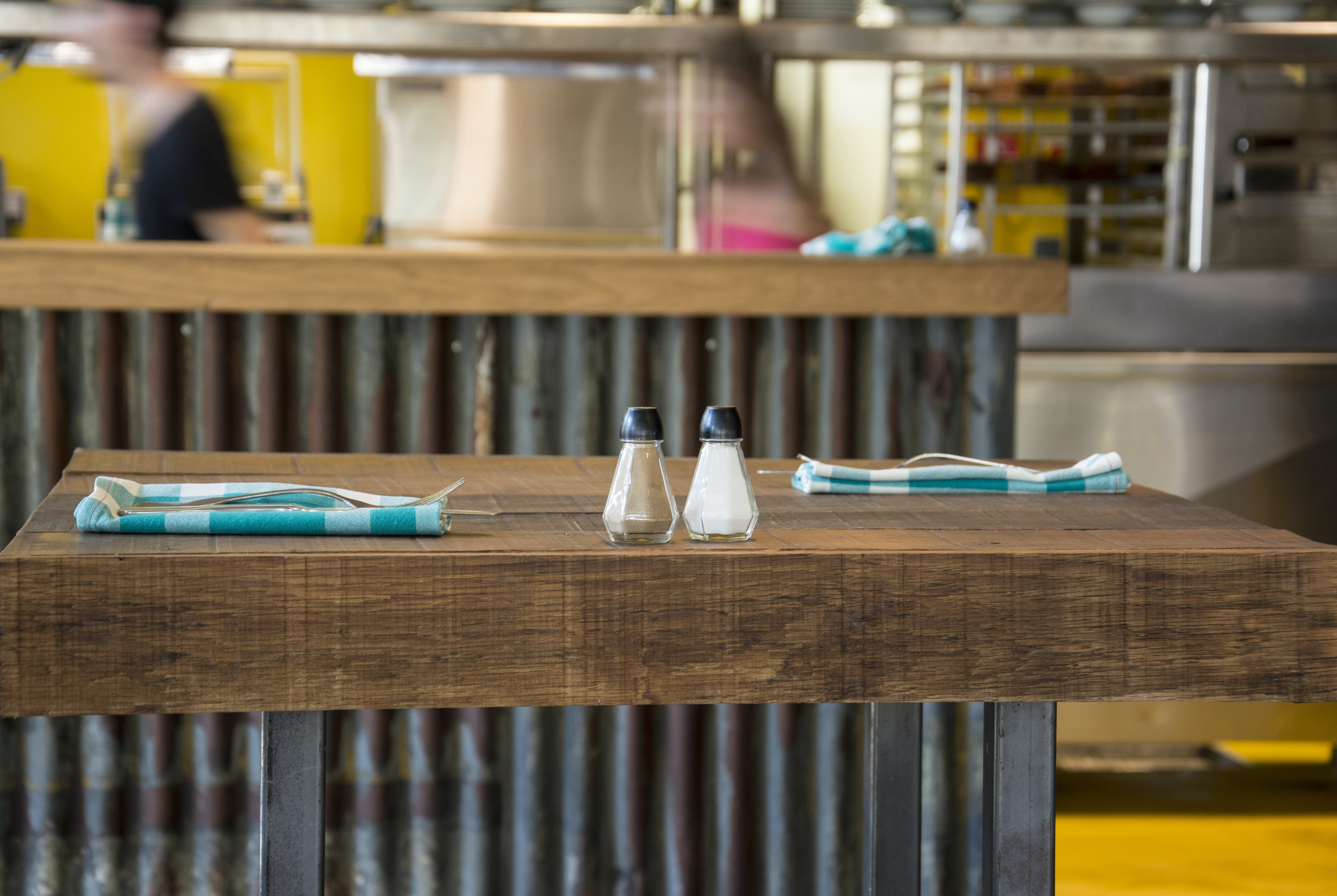 salt and pepper shakers on brown kitchen table