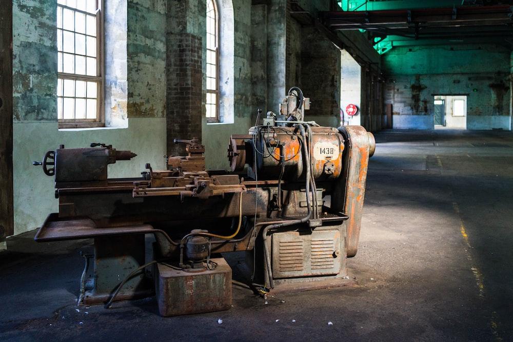 orange lathe machine in empty room