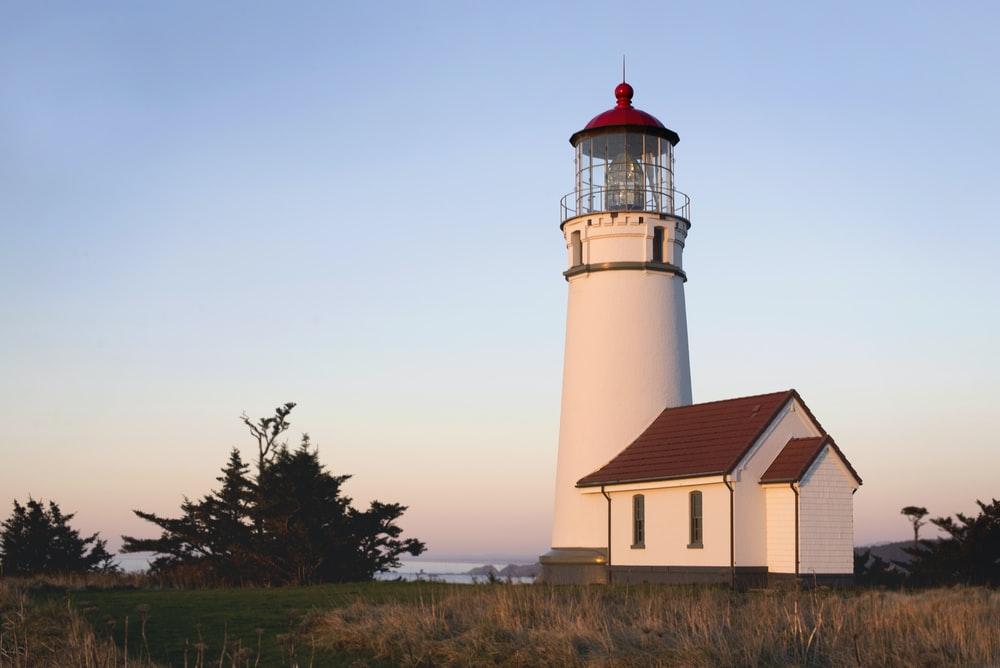 white and brown concrete lighthouse