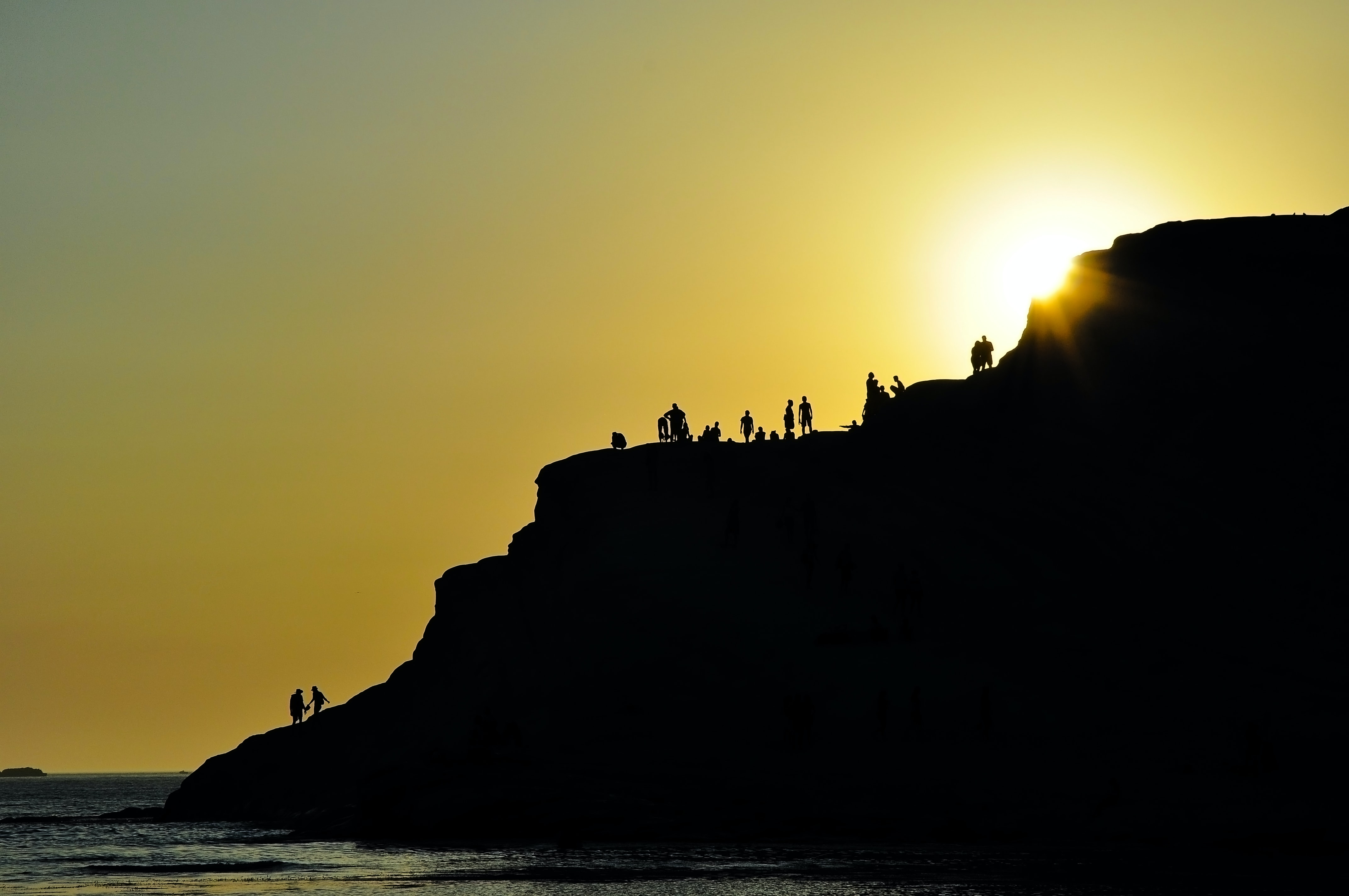 silhouette of group of people on hills