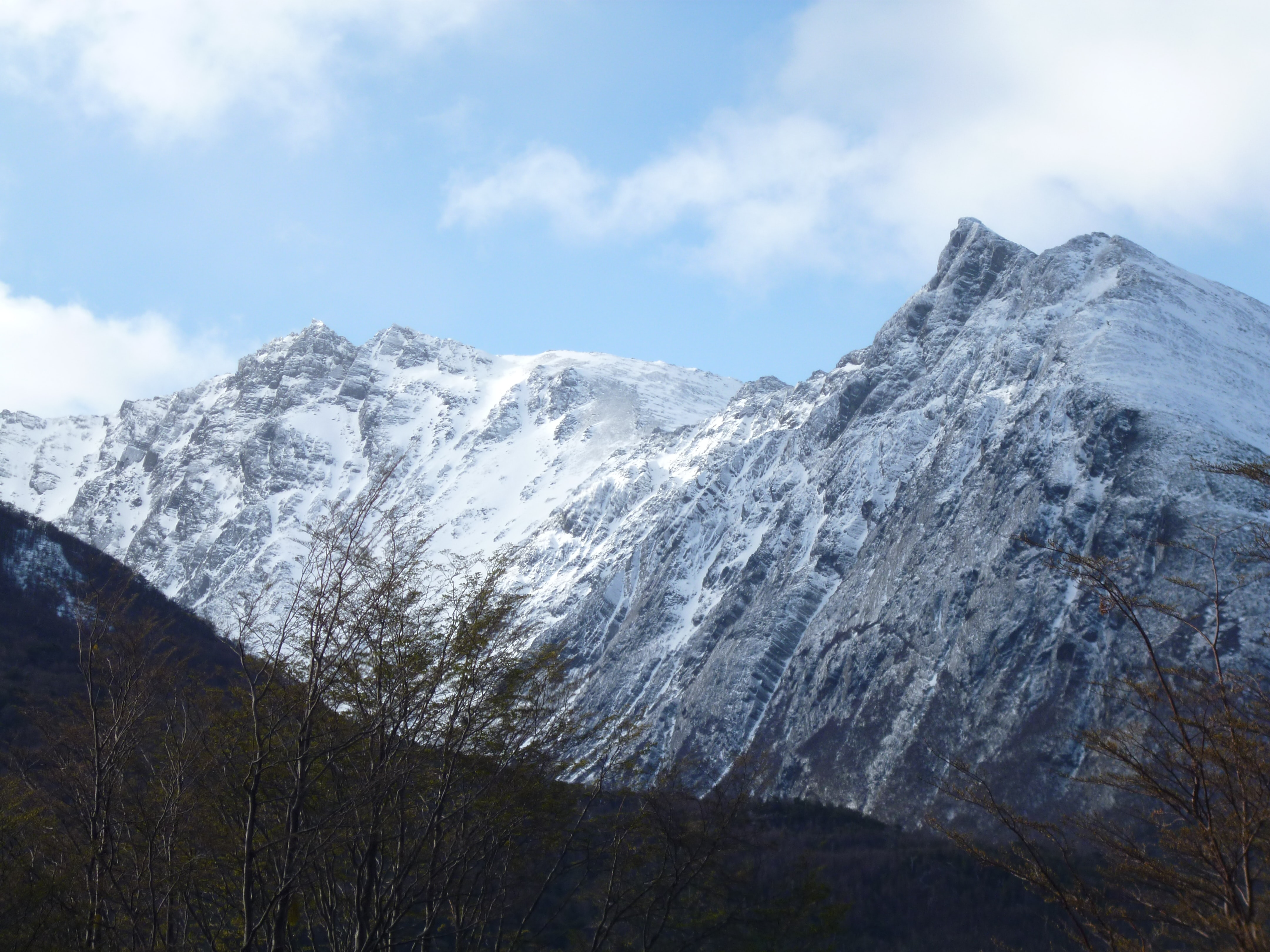 snow coated mountain during daytime