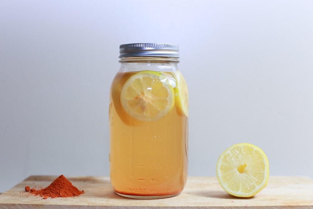clear glass mason jar on brown surface