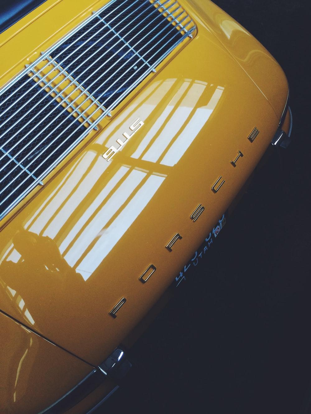 yellow and black Porsche vehicle
