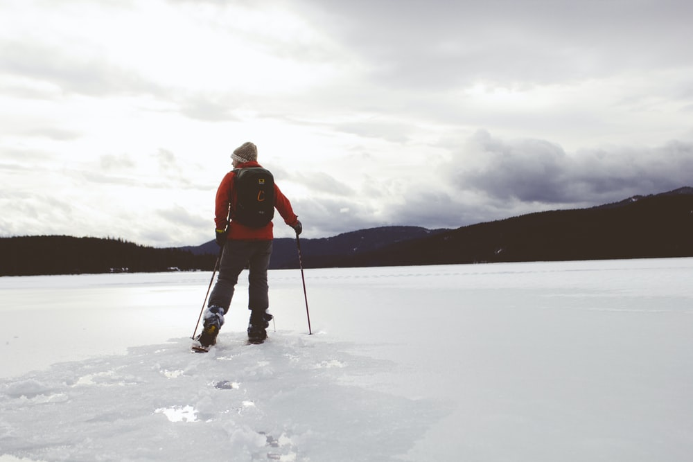 man standing on snow covered surface