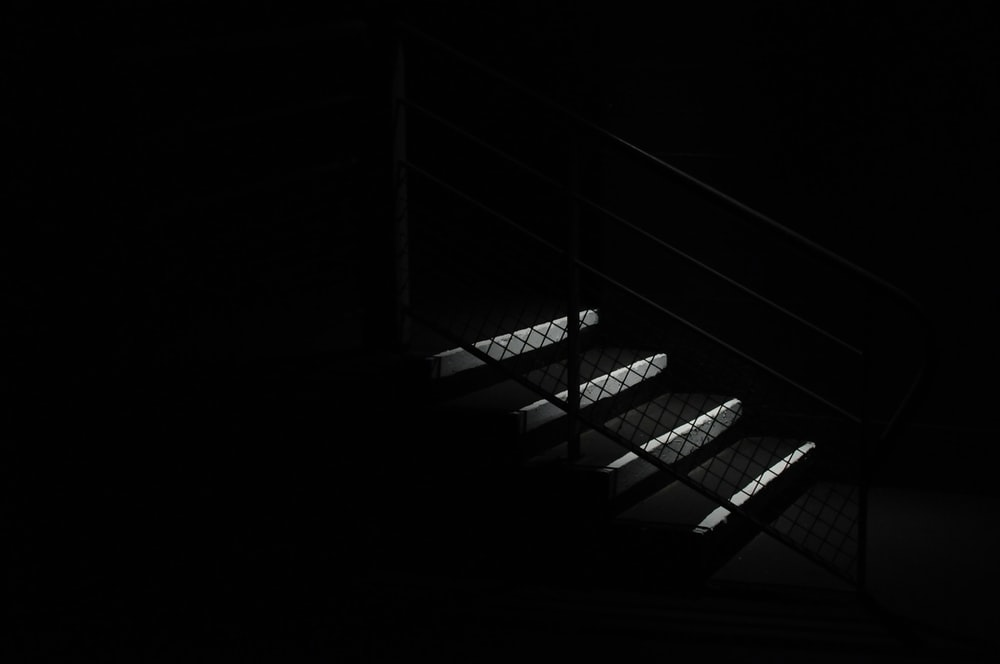 low light photography of black and white stair