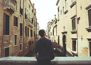 man standing in bridge