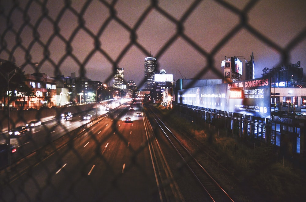time lapse photography of vehicles on roadway at night time