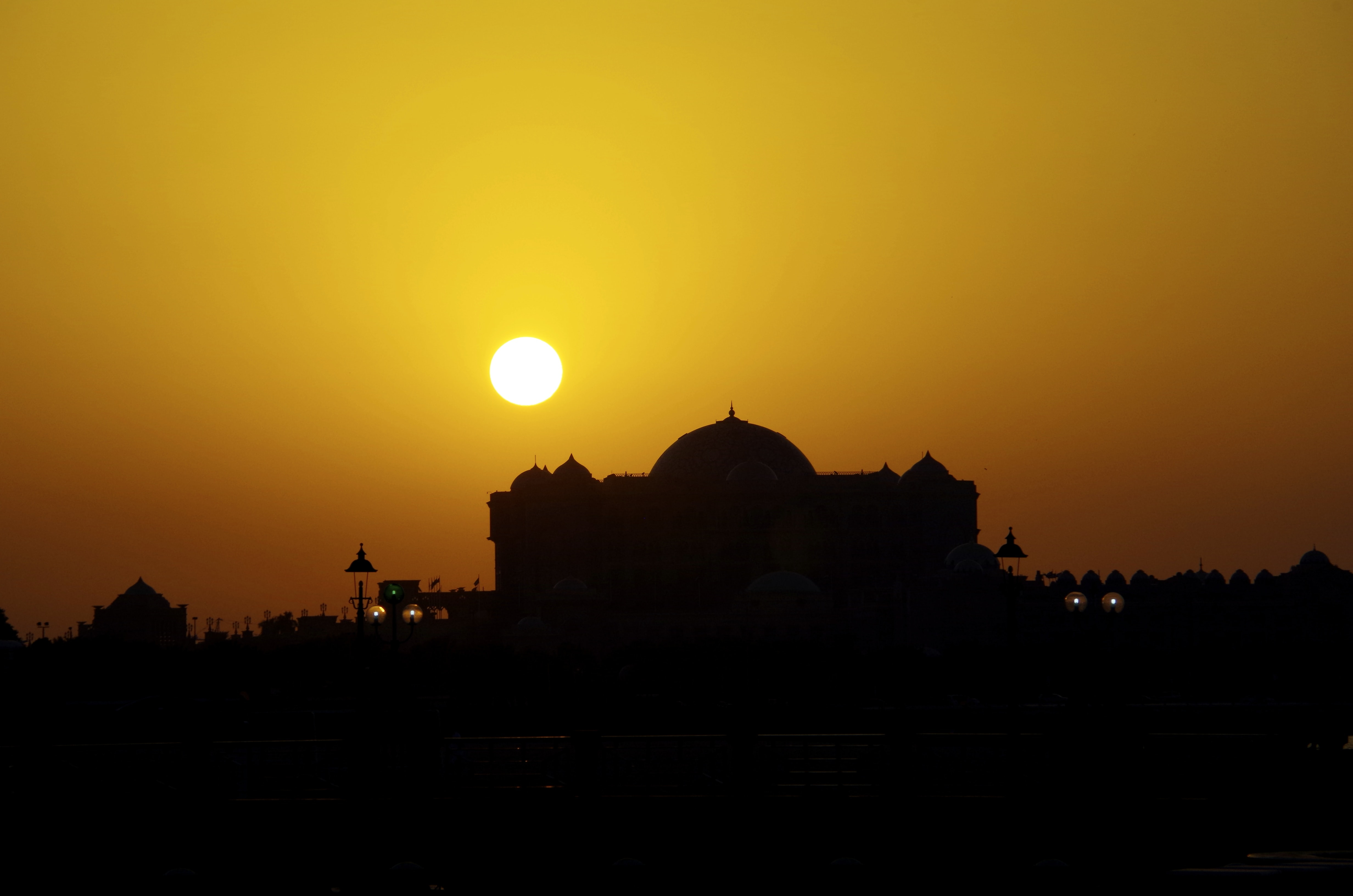 Silhouette of a mask at orange sunset in Abu Dhabi