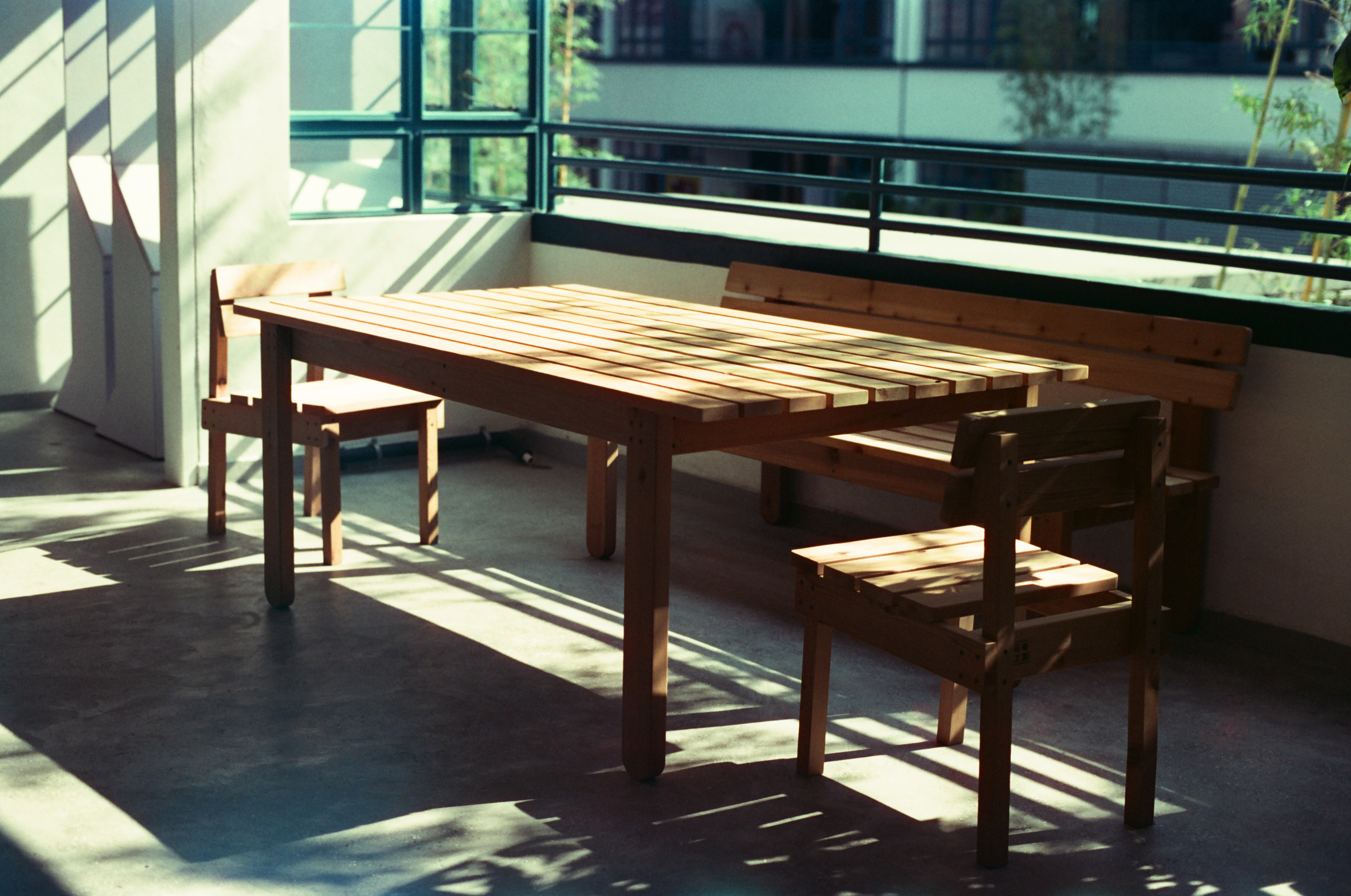 table and bench near window
