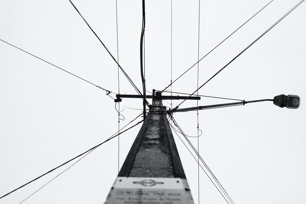 grayscale photo of cable wire