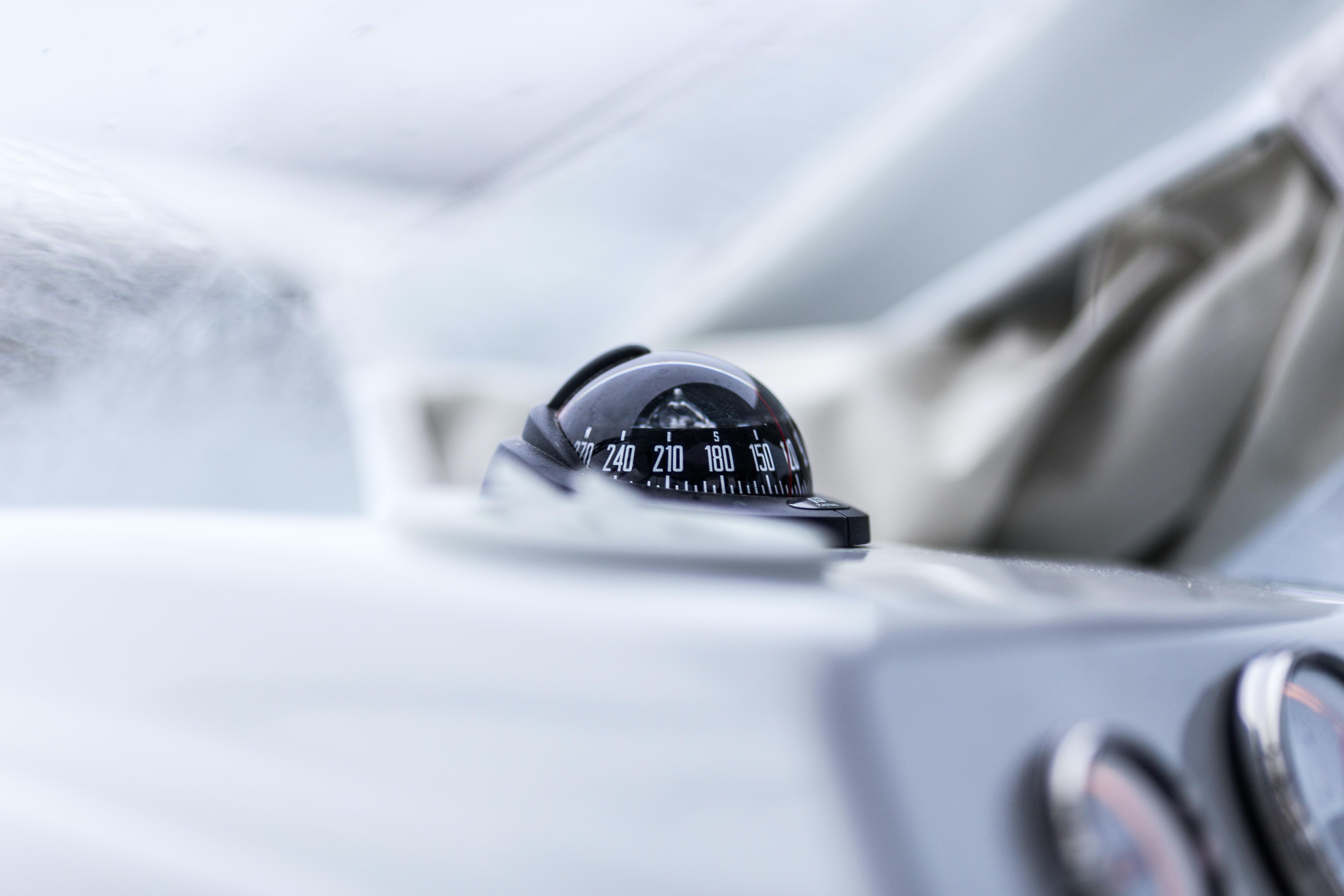 closeup photography of vehicle compass