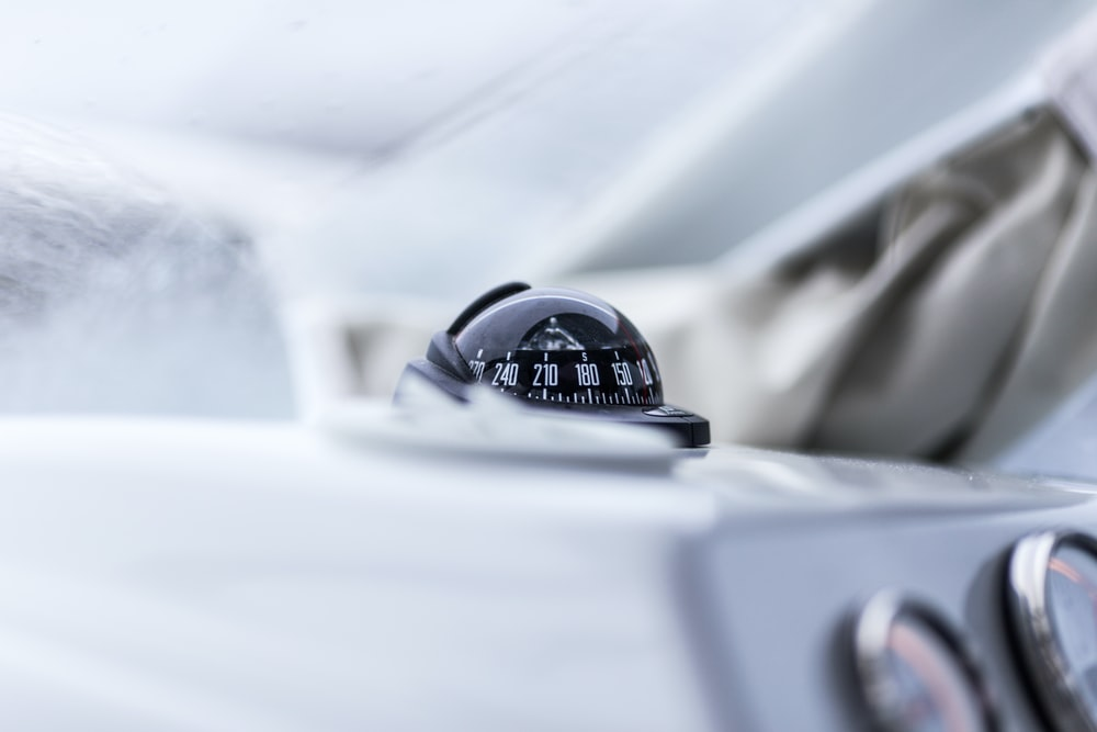 closeup photography of vehicle compass