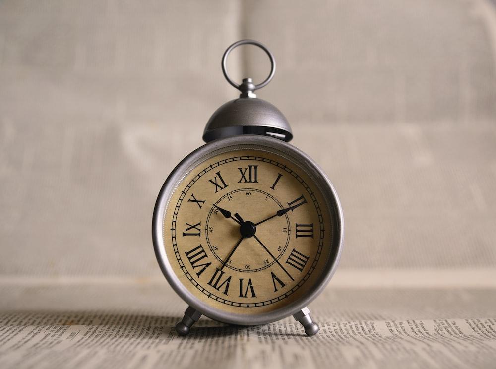 turned on gray alarm clock displaying 10:11
