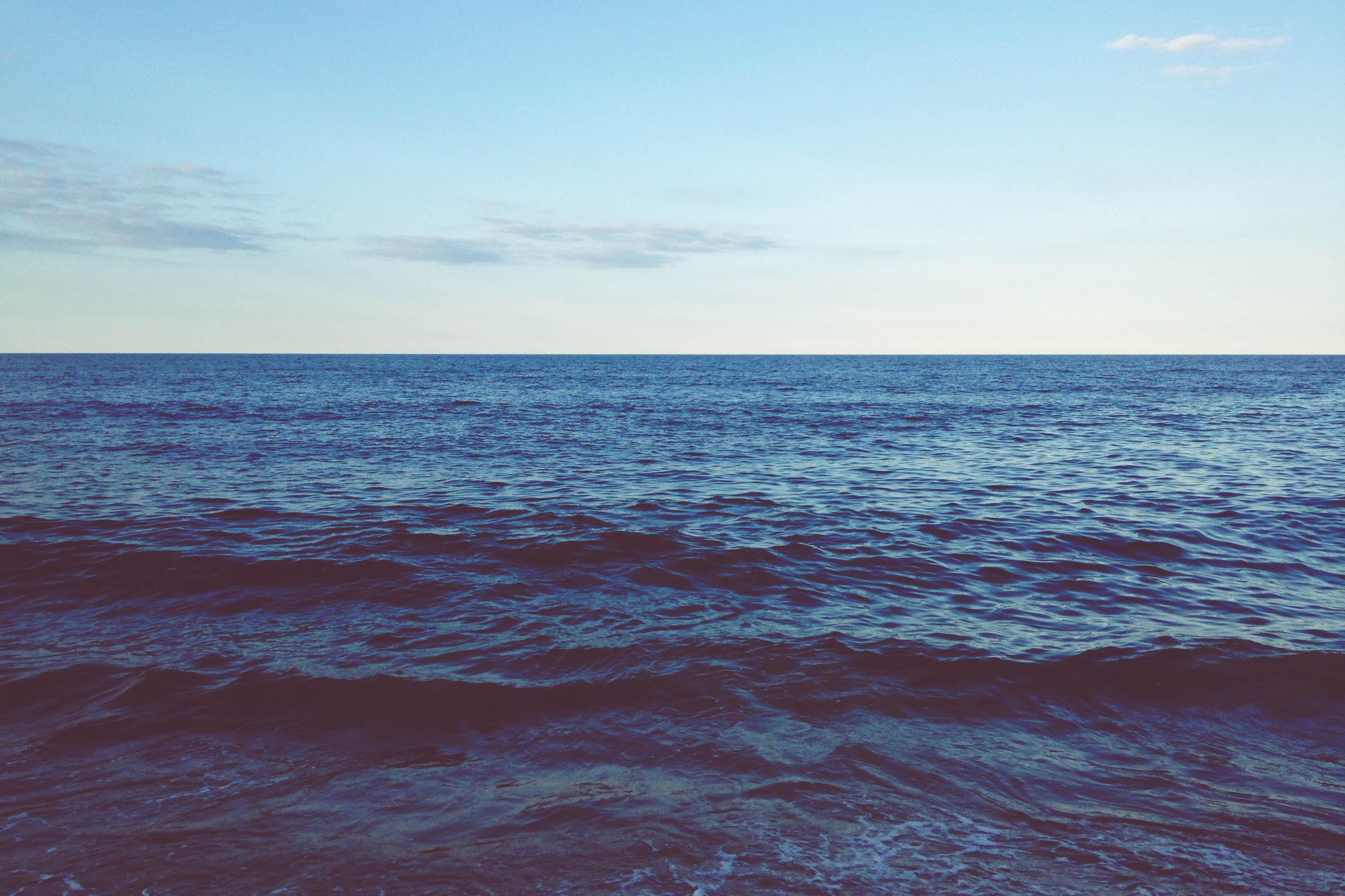 A dark blue choppy ocean stretching to the horizon