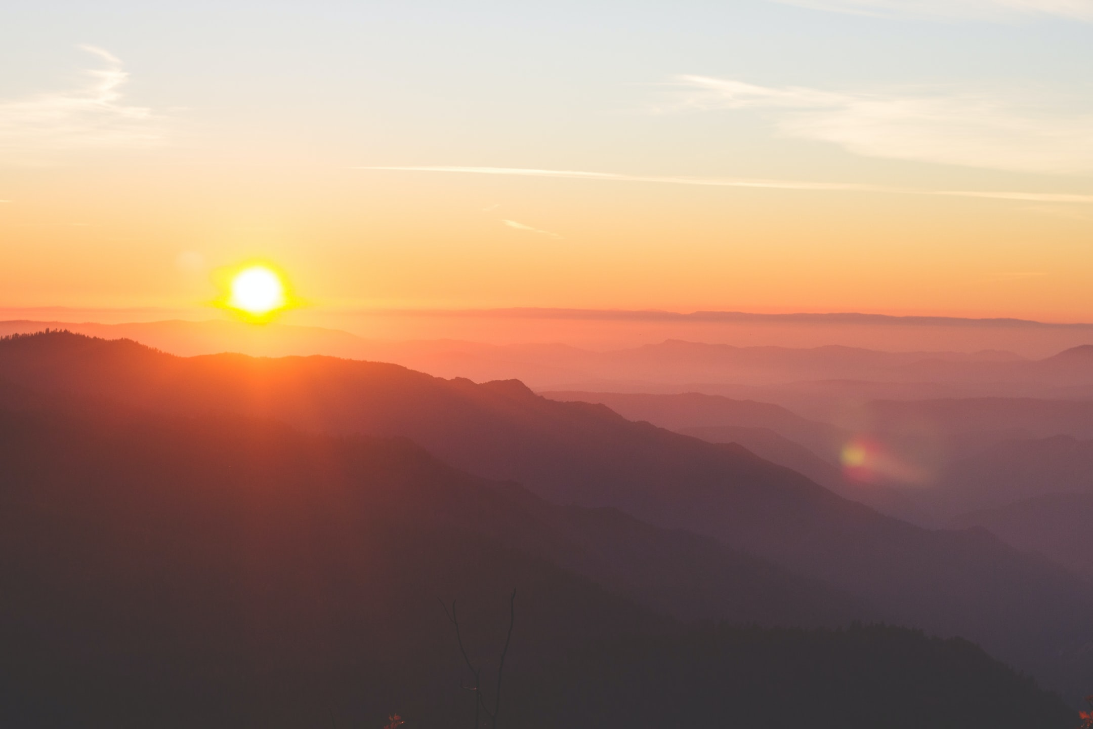 warm view of the sunrise at the summit in the dusk of morning