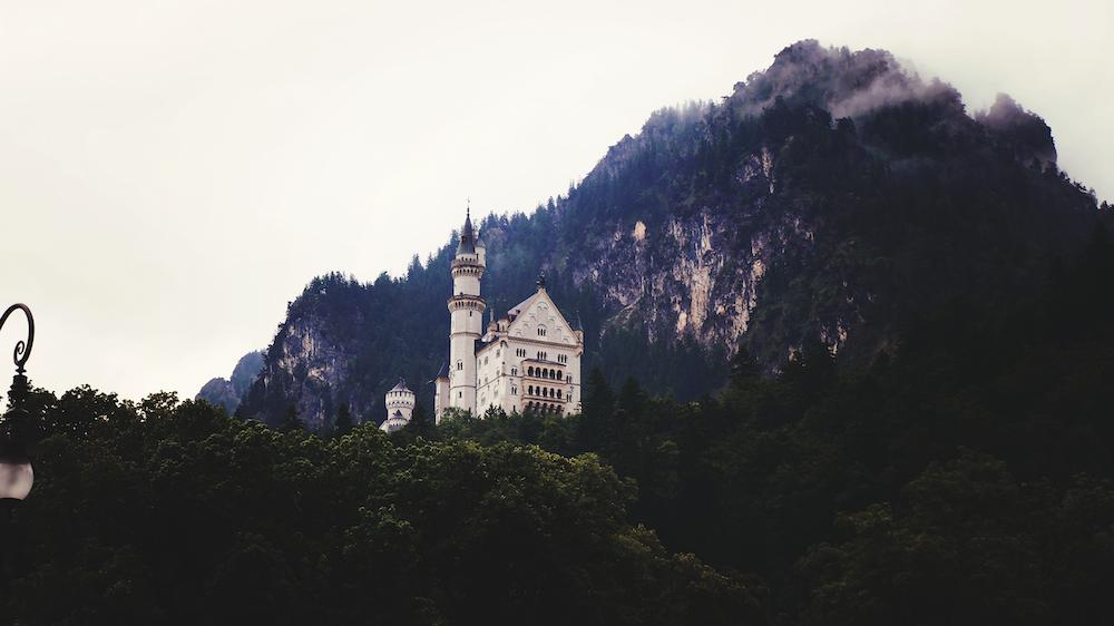 white concrete castle on top of mountain