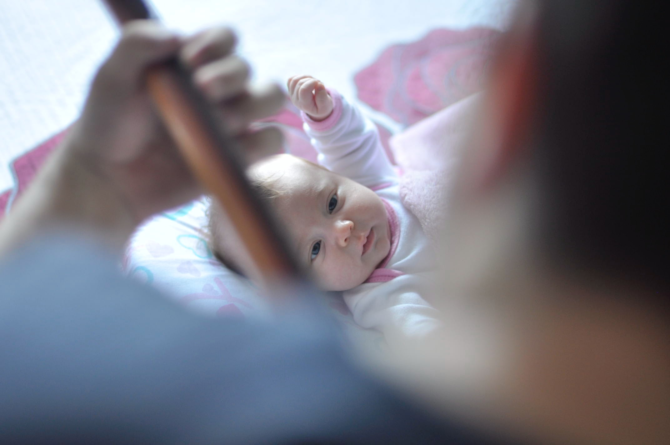 Parent playing guitar for baby
