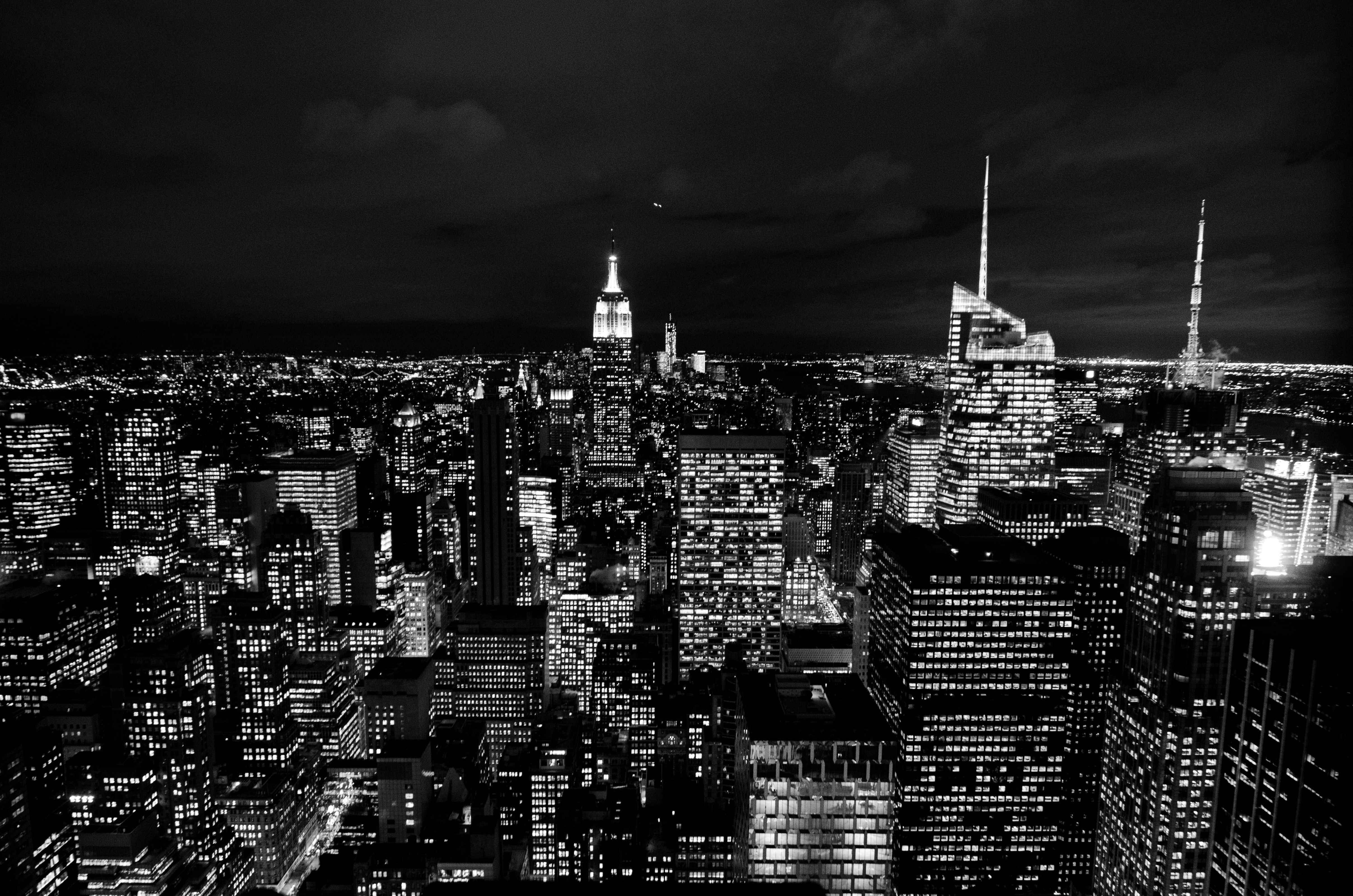 Black and white photo of the New York City skyscraper lights at night