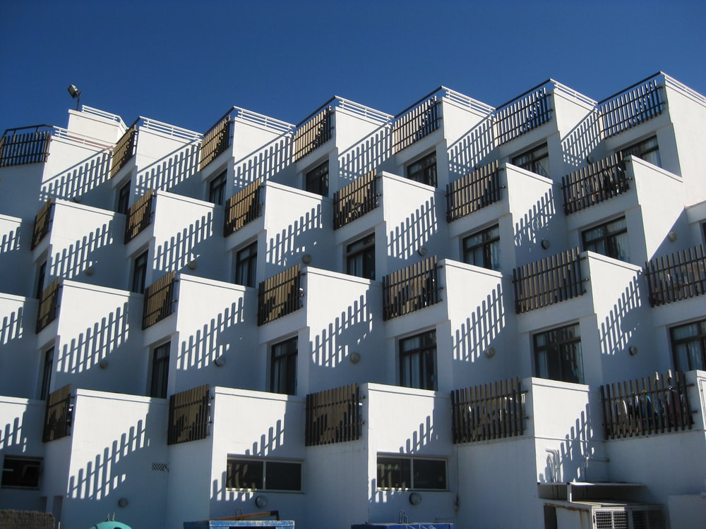 white concrete houses under blue sky
