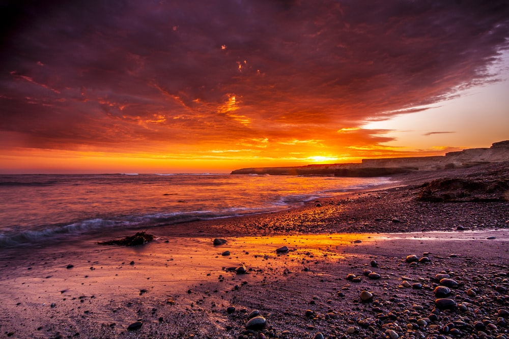 body of water under red sky photo
