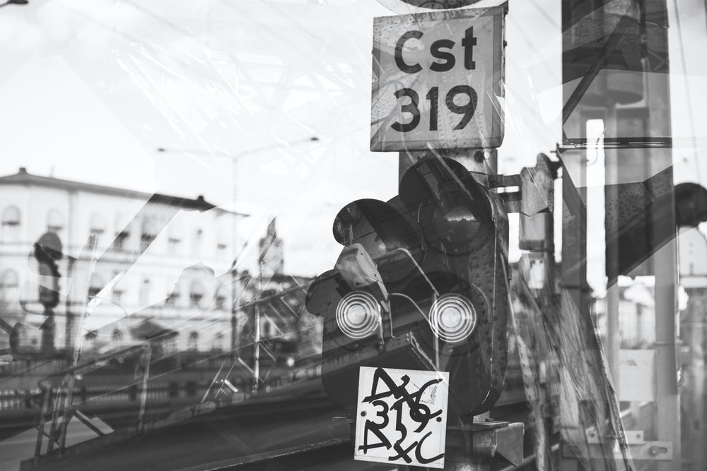 grayscale photo of stop light at daytime