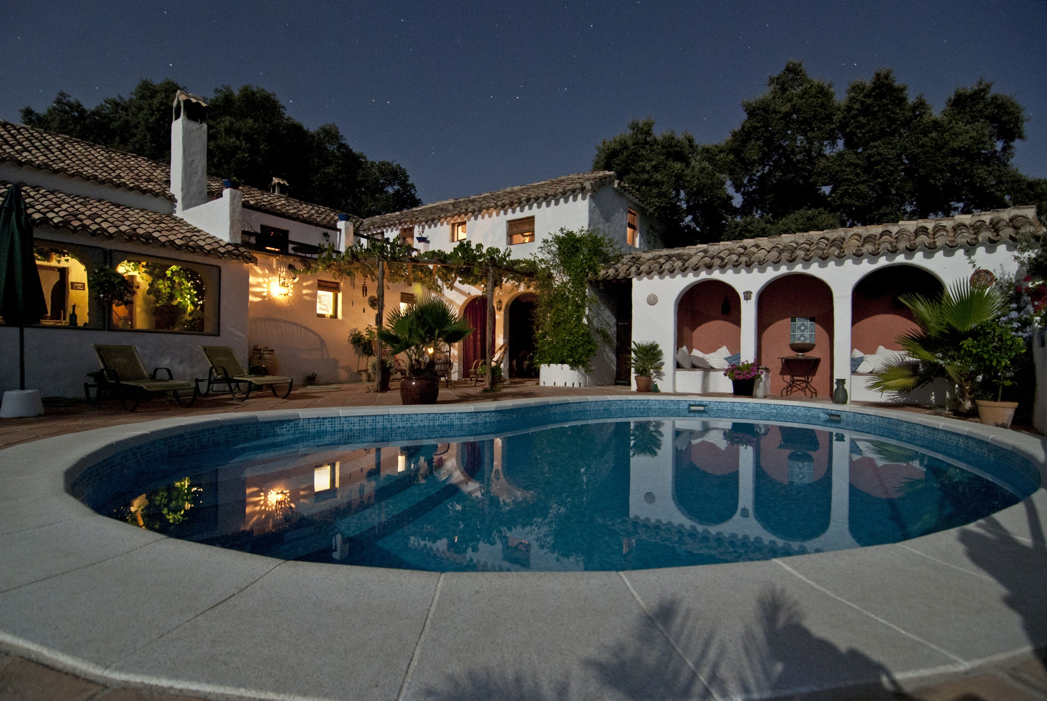 Nice home with a pool at night