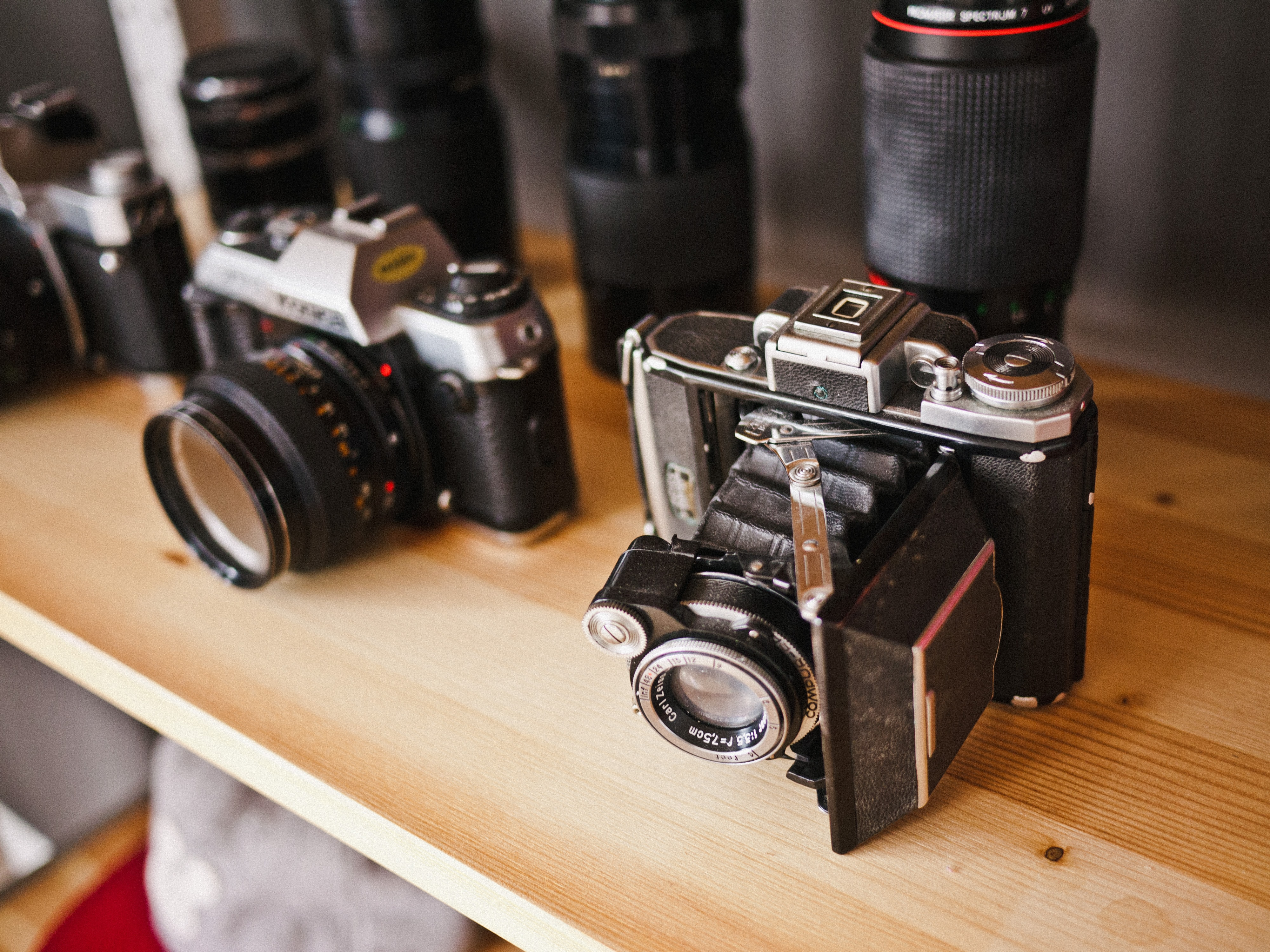 Vintage cameras and lenses on a shelf