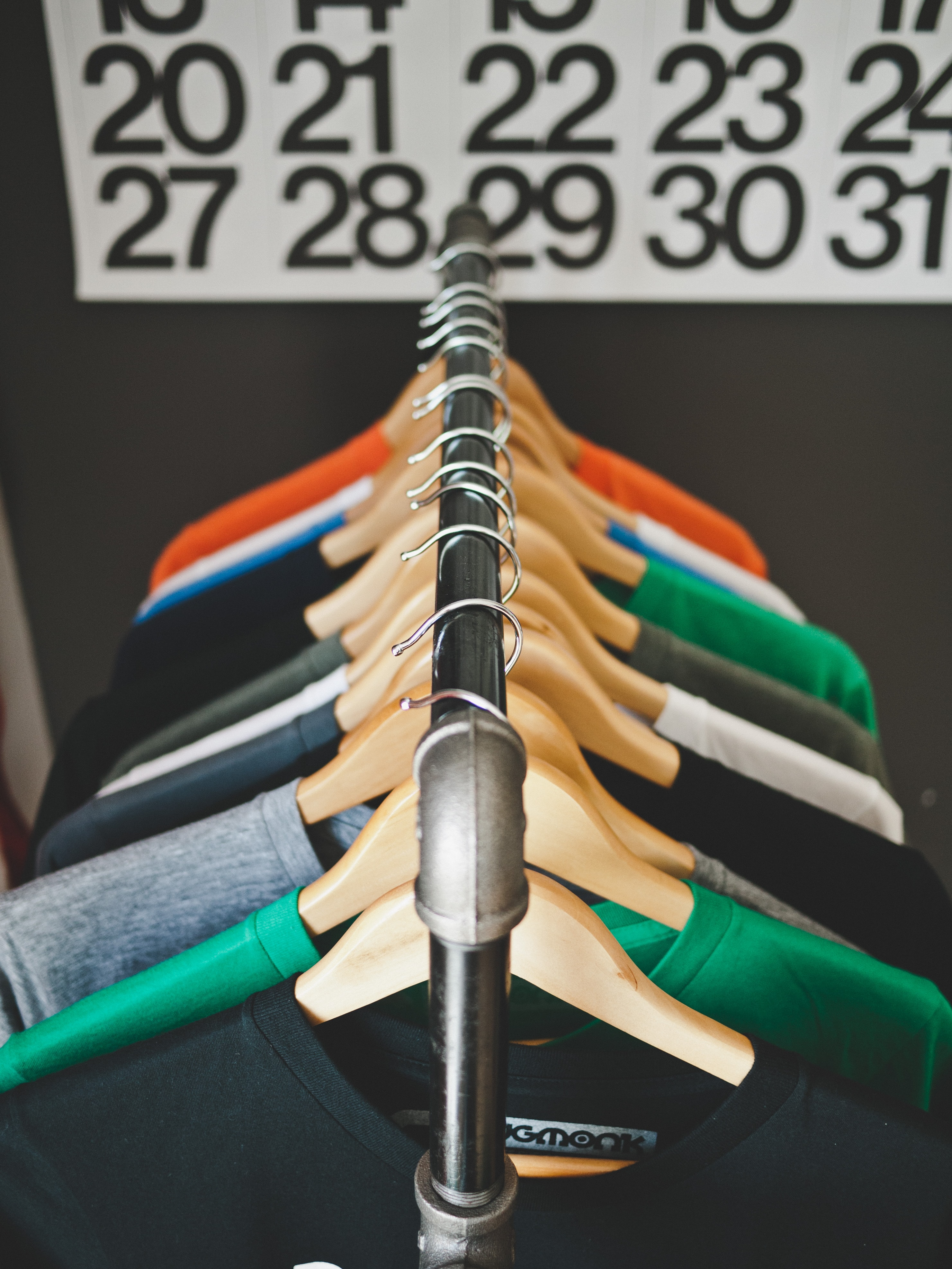 Colorful t-shirts on hangers in a clothing store