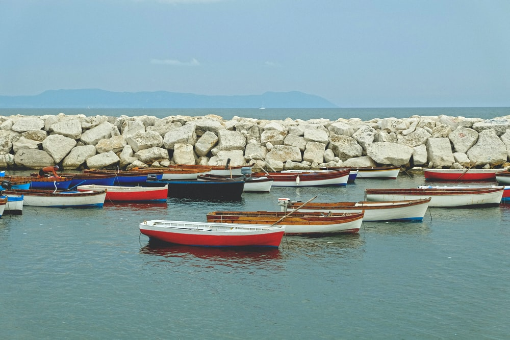 boats dock near the rocks