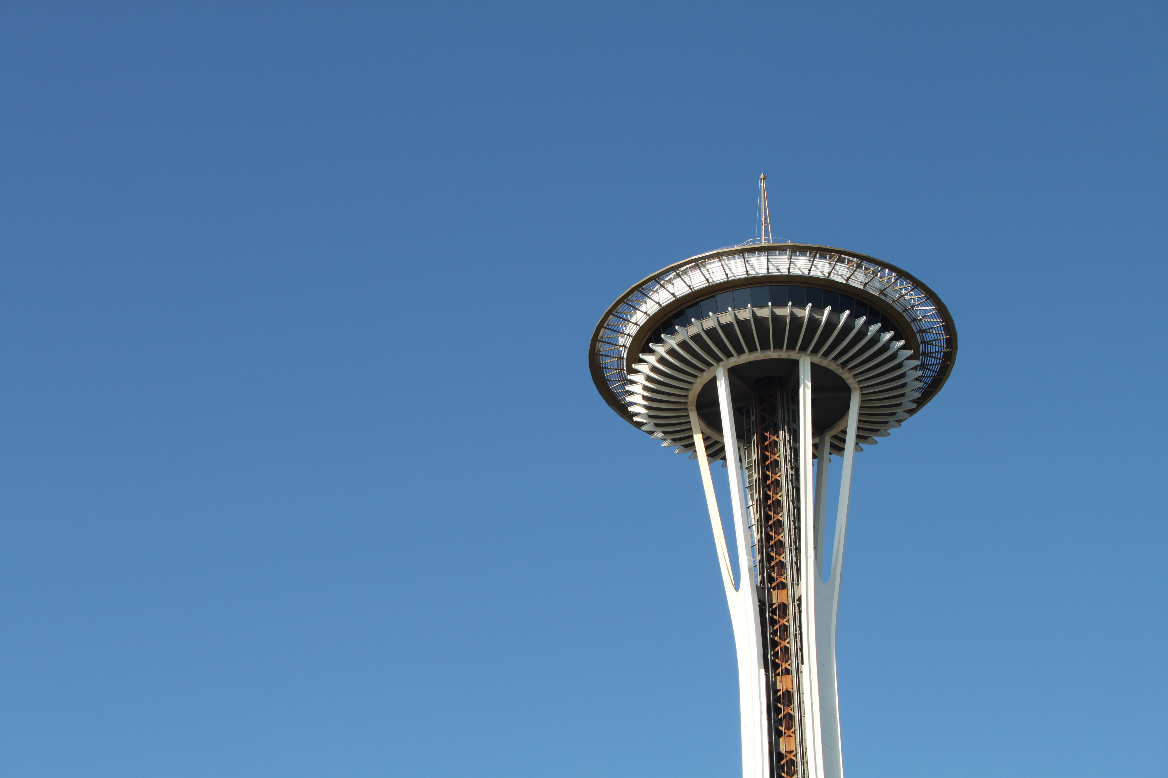 Iconic Seattle Space Needle against a blue sky