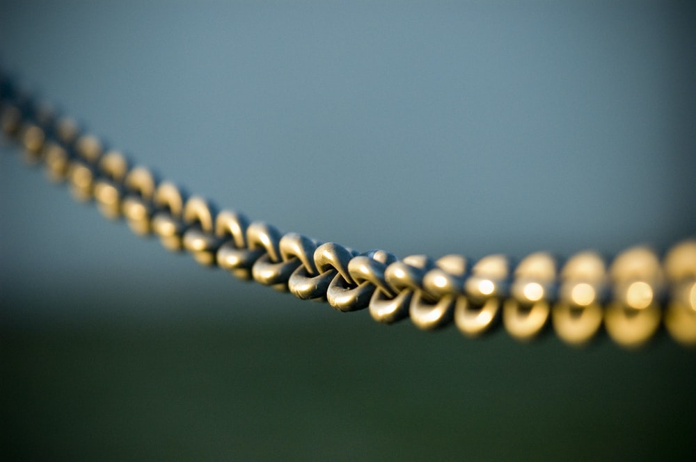 tilt shift photography of gray steel chains