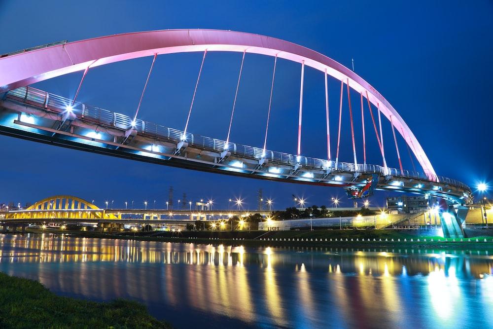 pink steel bridge during night