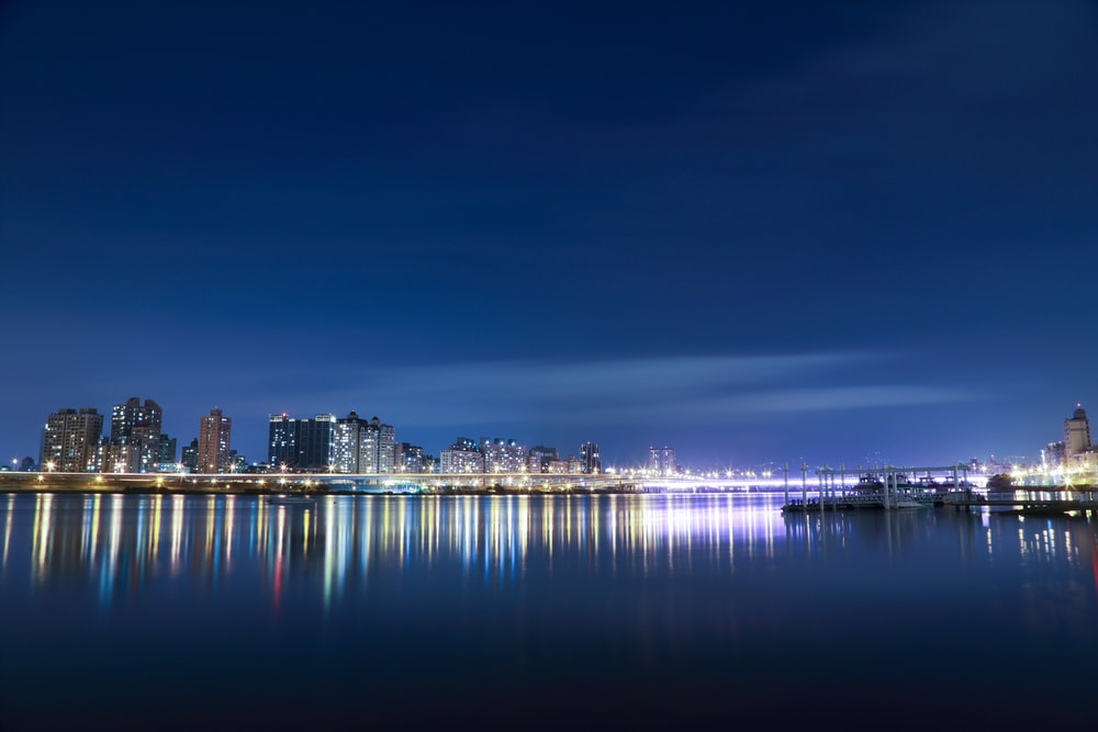 landscape photography of city town near body of water