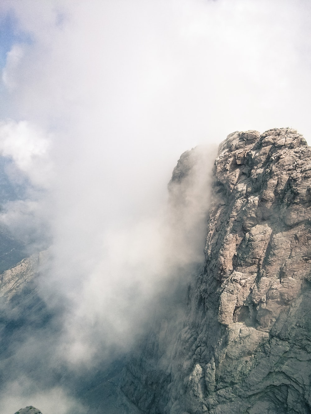 aerial view of mountains and fogs