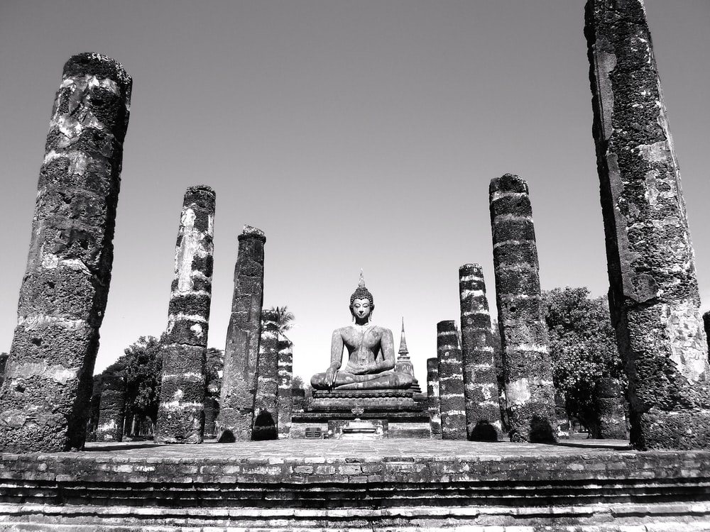 grayscale photo of buddha statue