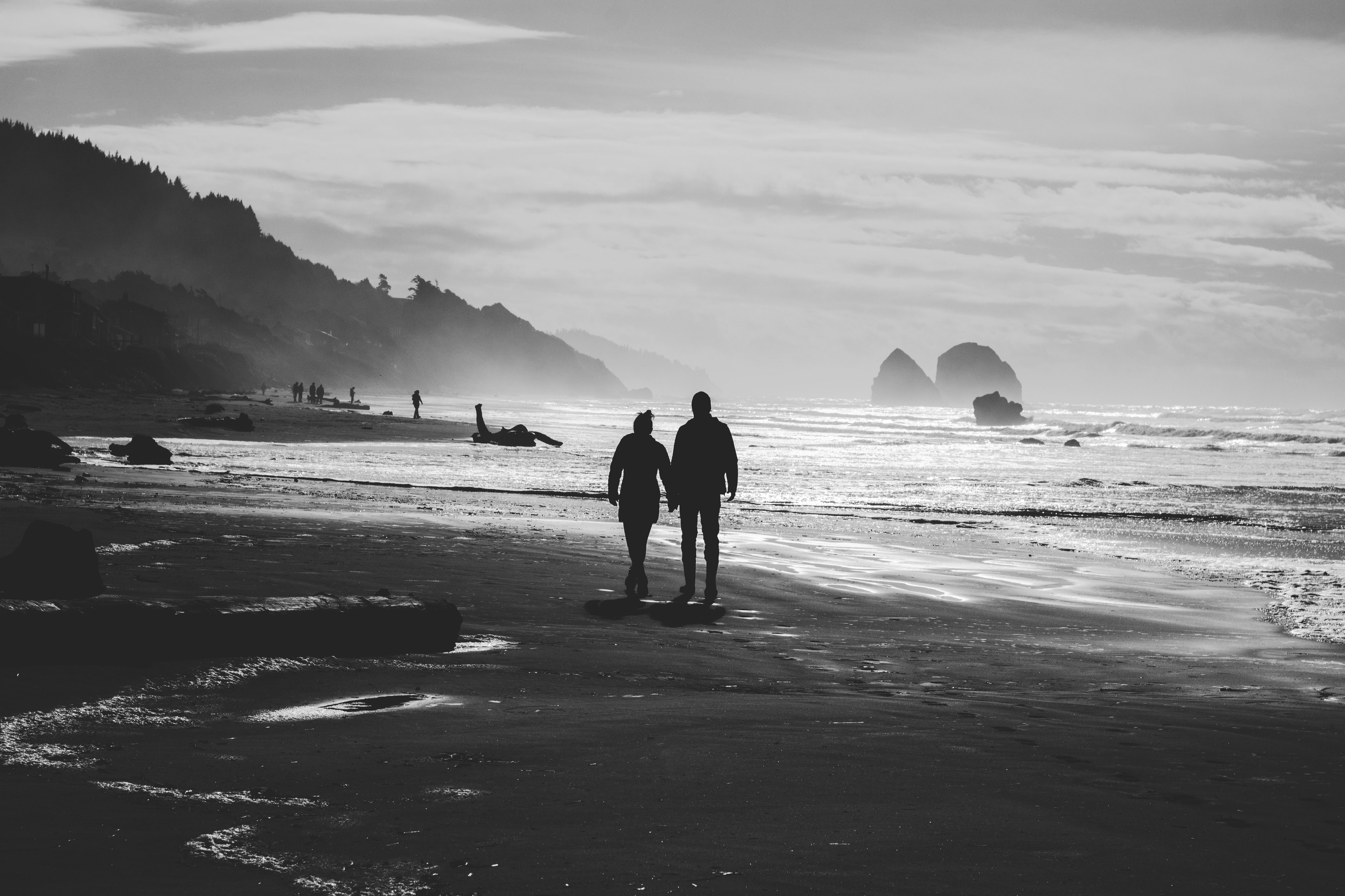 Hearty view of a couple holding hands and enjoying a walk on the beach