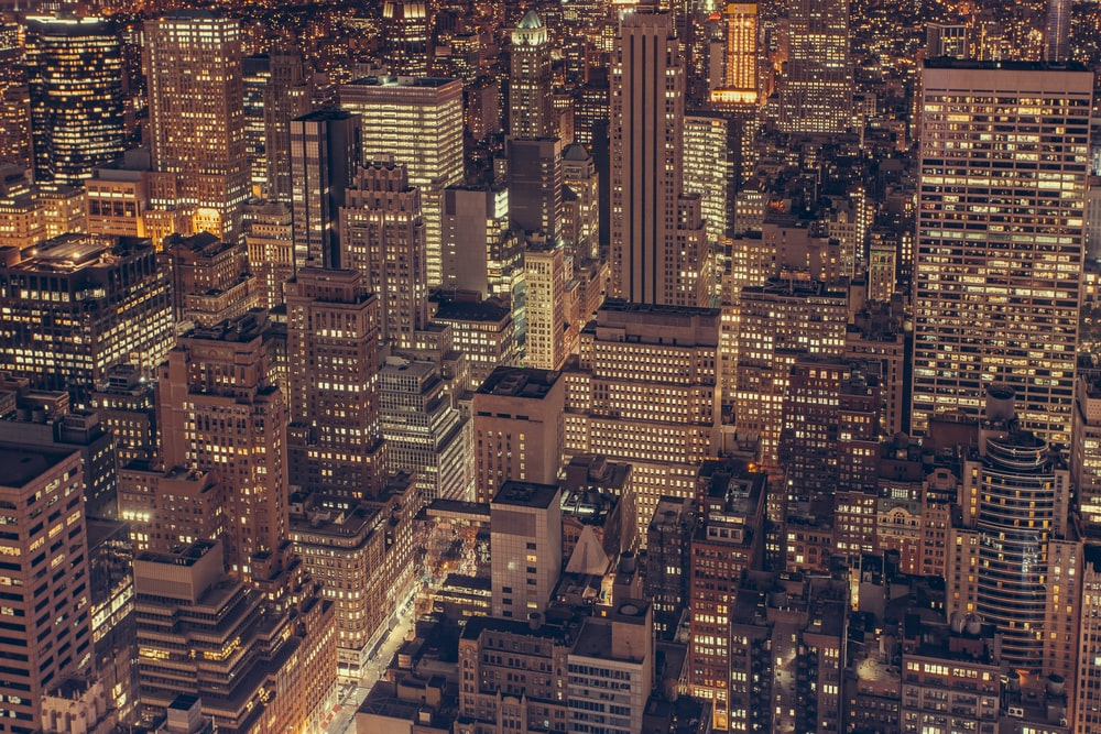 aerial photography of city buildings with lights