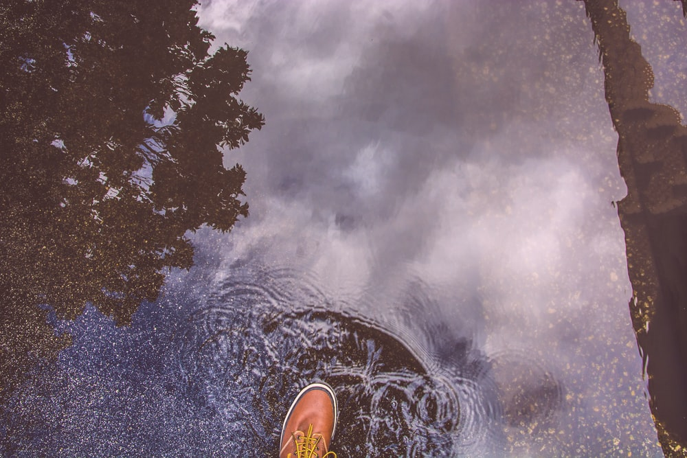 person stepping on water