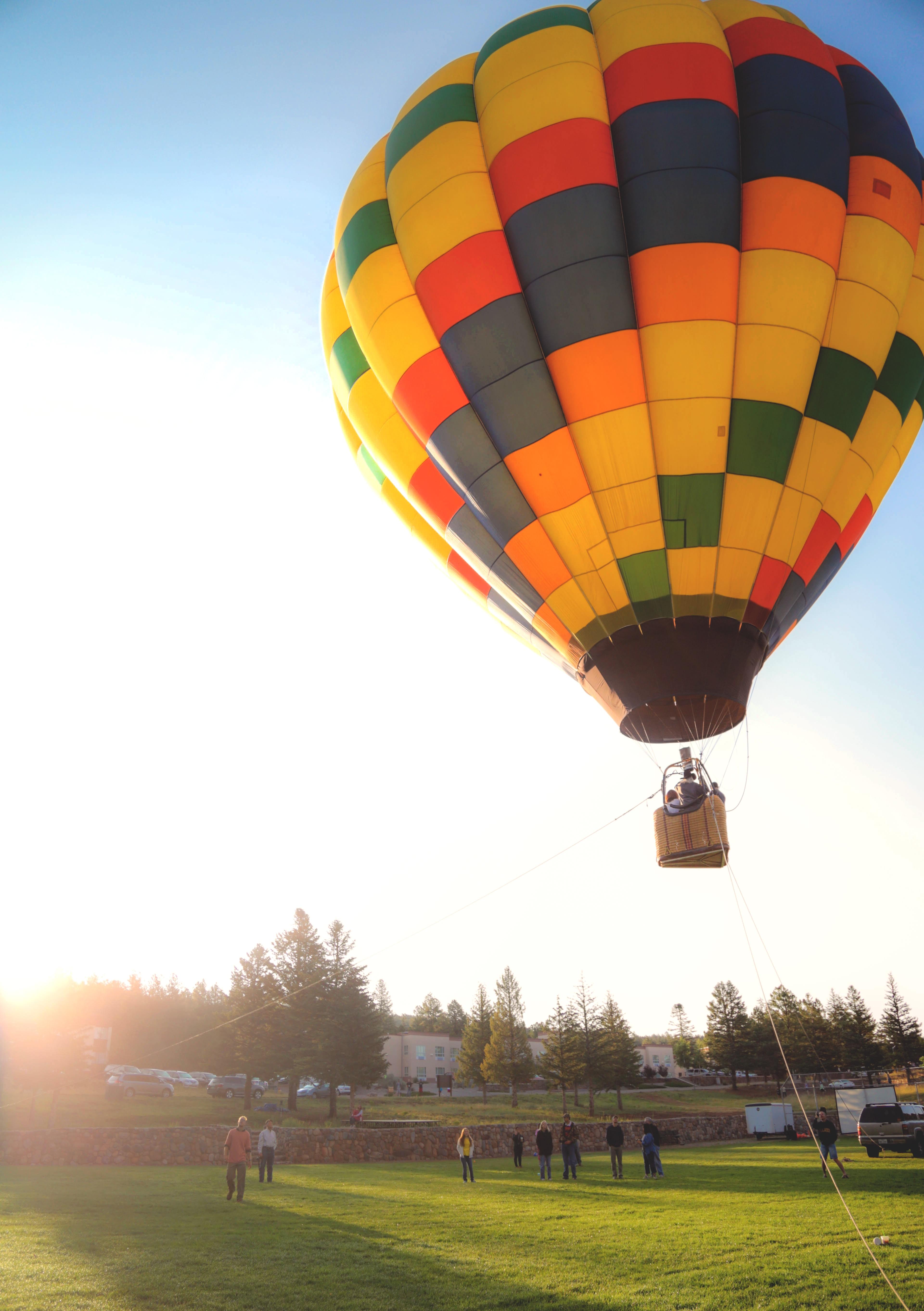 person riding hot air balloon