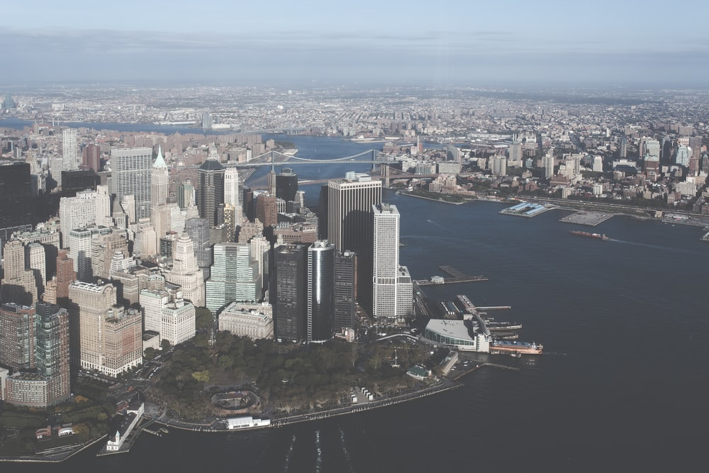 aerial view of buildings near body of water
