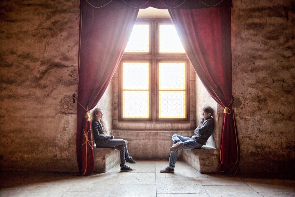 woman facing man in room