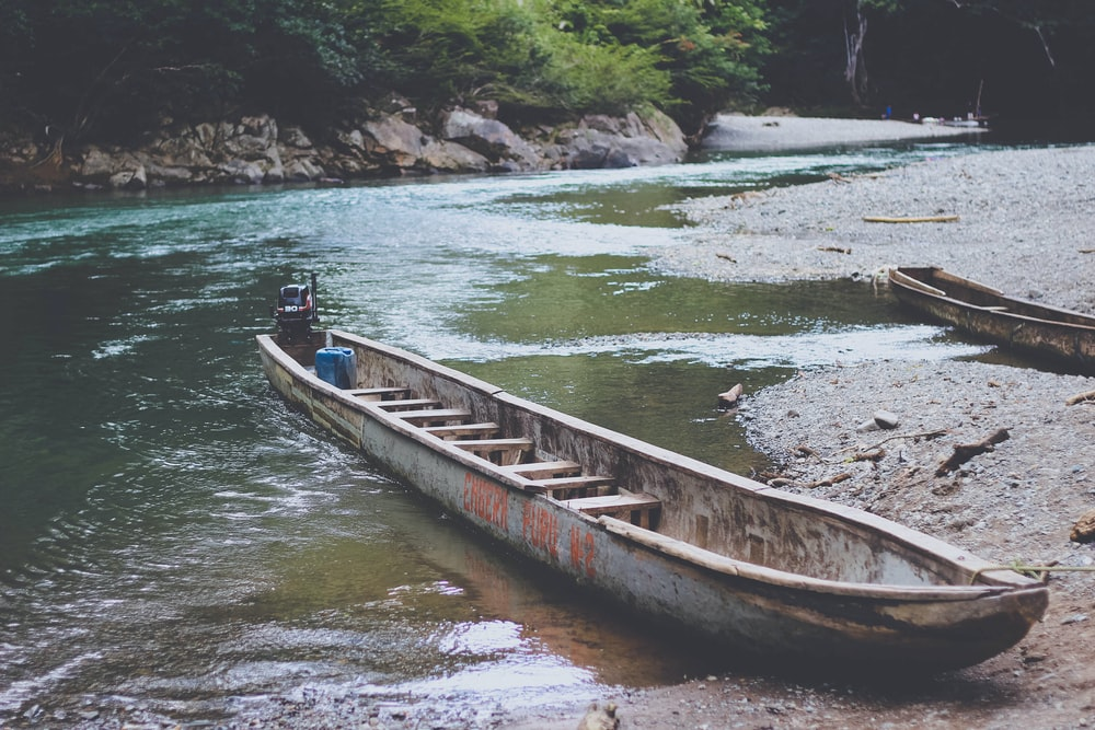 gray boat on the shore