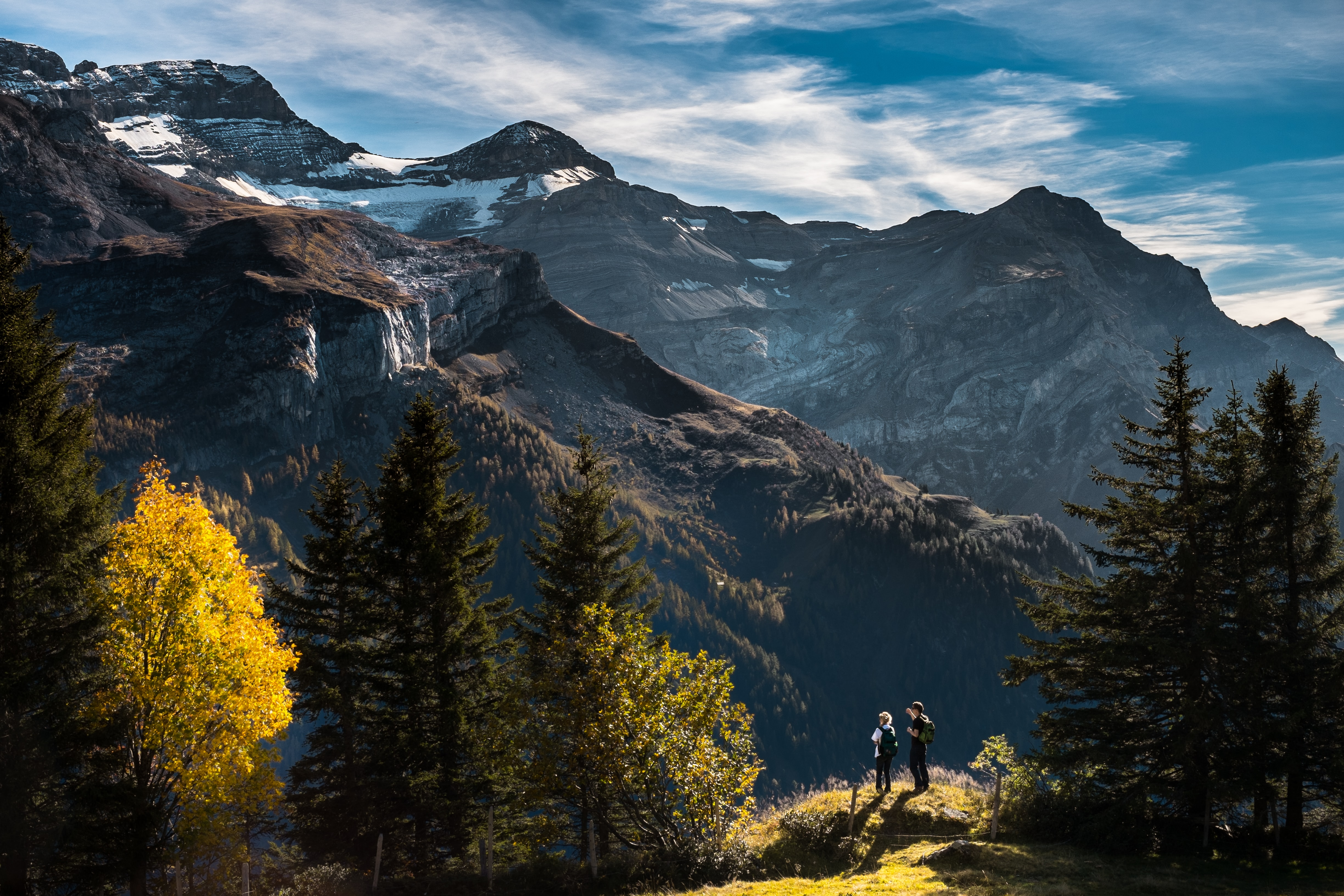two person standing on mountain