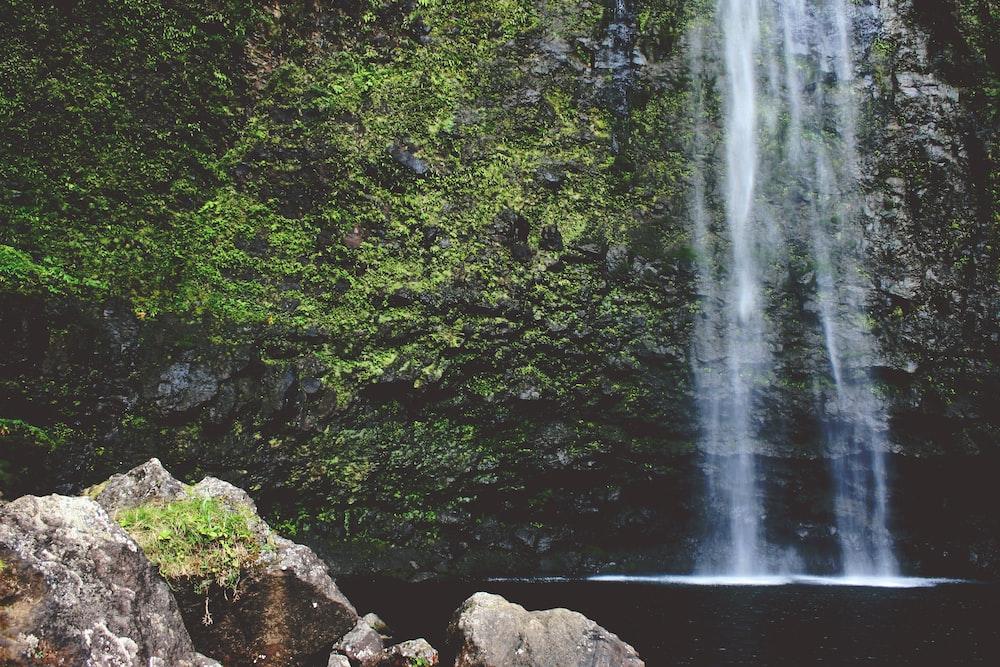 rock near waterfall