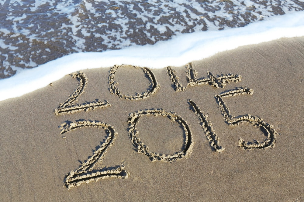 beach shore etch with 2014 and 2015 texts during daytime